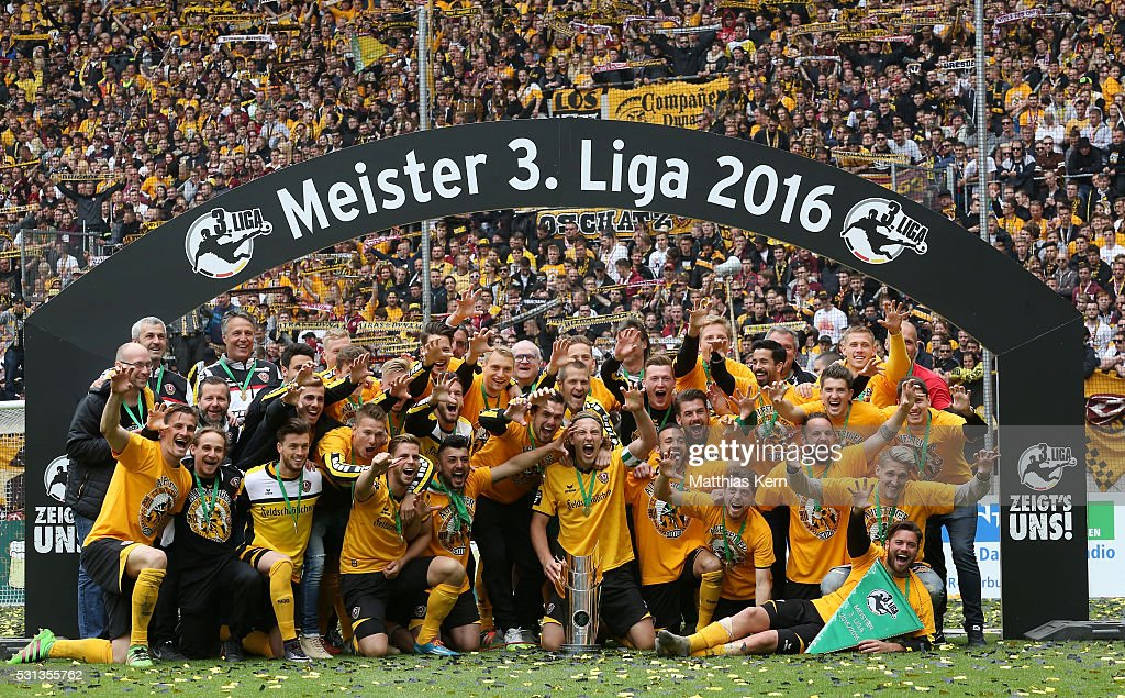 The players of Dresden pose with the trophy after the third league match between SG Dynamo Dresden and SG Sonnenhof Grossaspach at DDV Stadion Dresden on May 14, 2016 in Dresden, Germany.