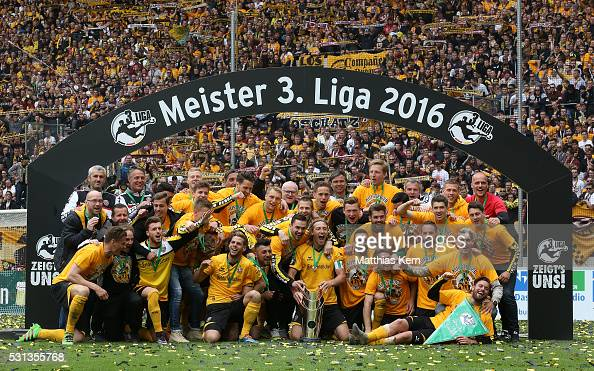 The players of Dresden pose with the trophy after the third league match between SG Dynamo Dresden and SG Sonnenhof Grossaspach at DDV Stadion...