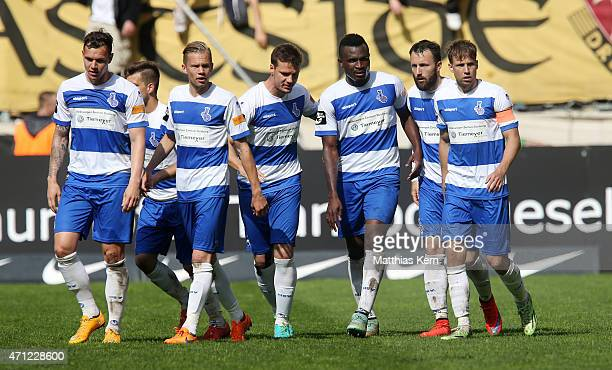 The players of Duisburg show their delight after winning the third league match between SG Dynamo Dresden and MSV Duisburg at GluecksgasStadion on...