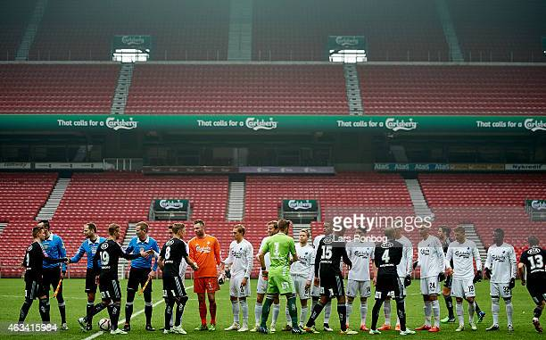 The players of FÇ Copenhagen and IFK Goteborg shake hands on an empty stadium prior to the PreSeason Friendly match between FC Copenhagen and IFK...