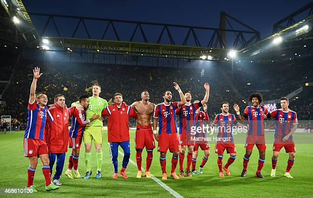 The players of FC Bayern Muenchen celebrate with the fans after the Bundesliga match between Borussia Dortmund and FC Bayern Muenchen at Signal Iduna...