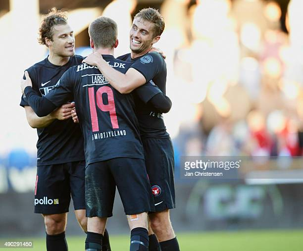 The players of FC Midtjylland celebrate after the Danish Alka Superliga match between Randers FC and FC Midtjylland at BioNutria Park Randers on...