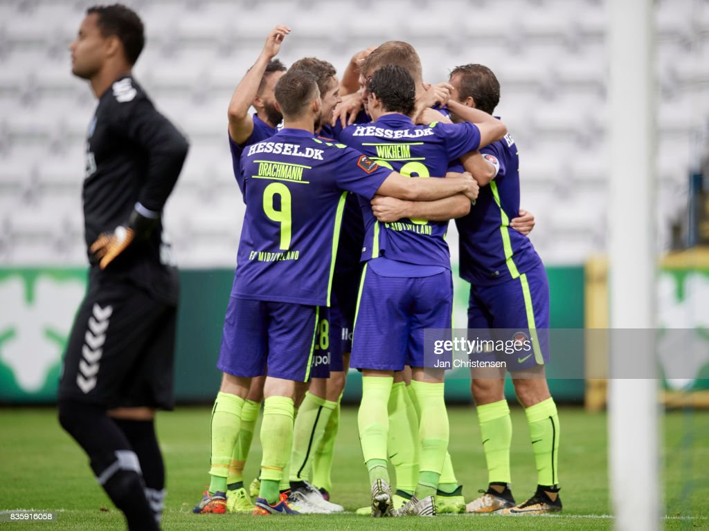 The players of FC Midtjylland celebrate the 0-1 goal from Alexander Sorloth during the Danish Alka Superliga match between OB Odense and FC Midtjylland at TREFOR Park on August 20, 2017 in Odense, Denmark.