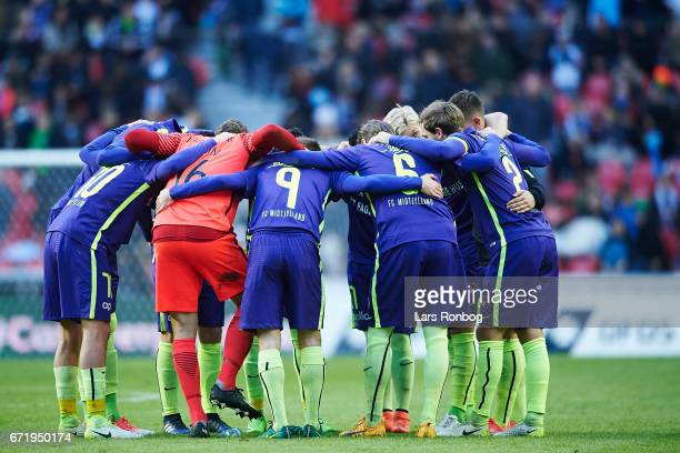 The players of FC Midtjylland huddle prior to the second half in the Danish Alka Superliga match between FC Copenhagen and FC Midtjylland at Telia...