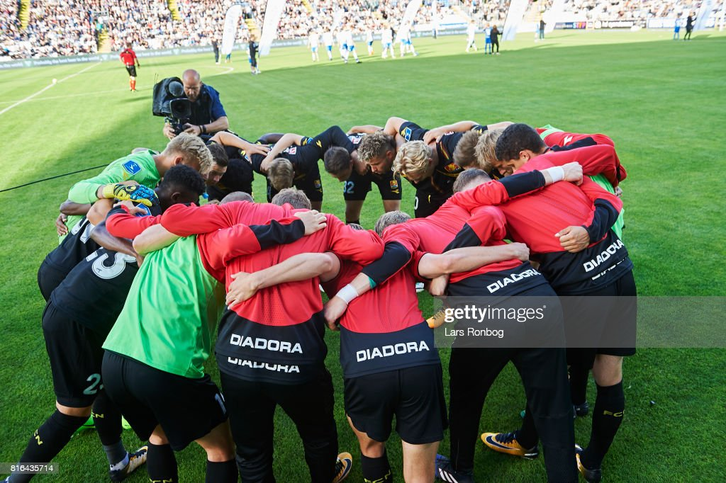 The players of FC Nordsjalland huddle prior to the Danish Alka Superliga match between OB Odense and FC Nordsjalland at EWII Park on July 17, 2017 in Odense, Denmark.