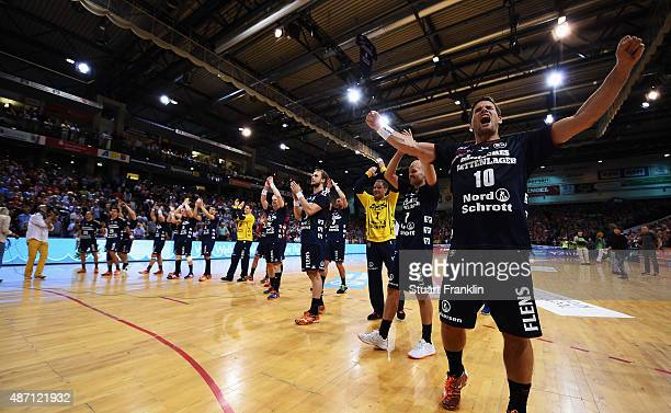 The players of Flensburg celebrate their win during the DKB Handball Bundeslga match between SG FlensburgHandewitt and THW Kiel at FlensArena on...