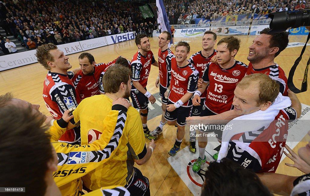 The players of Flensburg celebrates at the end of the Toyota Bundesliga handball game between SG Flensburg-Handewitt and Rhein-Neckar Loewen at the Flens arena on March 20, 2013 in Flensburg, Germany.