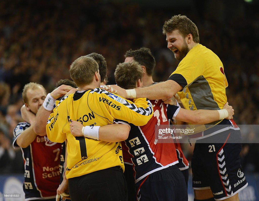 The players of Flensburg celebrates at the end of the Toyota Bundesliga handball game between SG Flensburg-Handewitt and Rhein-Neckar Loewen at the Flens arena on March 20, 2013 in Flensburg, Germany.