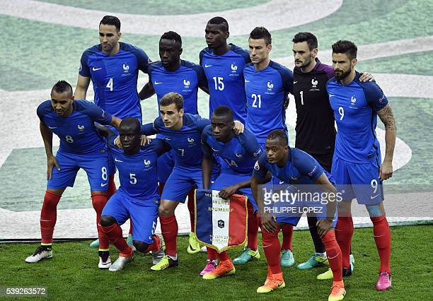 The players of France's national football team France's forward Dimitri Payet France's midfielder N'Golo Kante France's forward Antoine Griezmann...