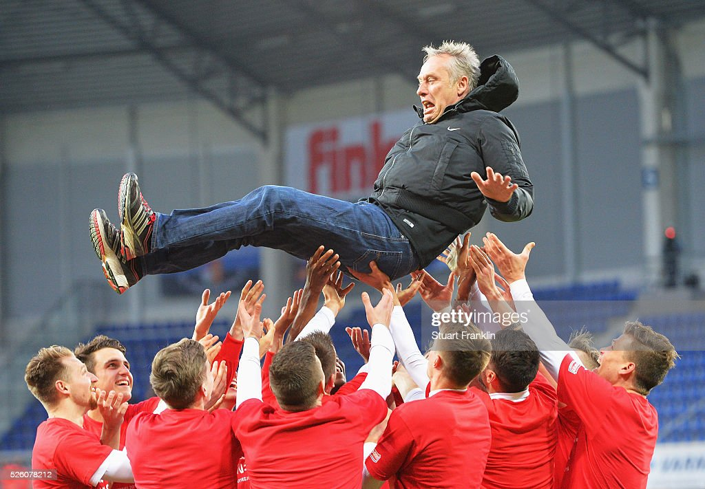The players of Freiburg celebrate promotion to the first Bundesliga by throwing <a gi-track='captionPersonalityLinkClicked' href=/galleries/search?phrase=Christian+Streich&family=editorial&specificpeople=4411796 ng-click='$event.stopPropagation()'>Christian Streich</a>, head coach of Freiburg in the air after the second Bundesliga match between SC Paderborn and SC Freiburg at the Benteler Arena on April 29, 2016 in Paderborn, North Rhine-Westphalia.