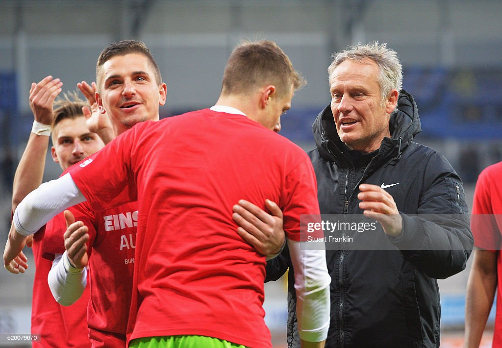 The players of Freiburg celebrate promotion to the first Bundesliga with Christian Streich, head coach of Freiburg after the second Bundesliga match between SC Paderborn and SC Freiburg at the Benteler Arena on April 29, 2016 in Paderborn, North Rhine-Westphalia.