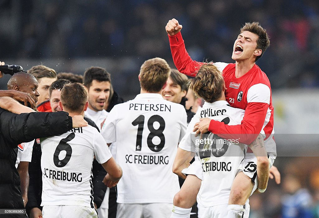 The players of Freiburg celebrate promotion to the first Bundesliga after the second Bundesliga match between SC Paderborn and SC Freiburg at the Benteler Arena on April 29, 2016 in Paderborn, North Rhine-Westphalia.