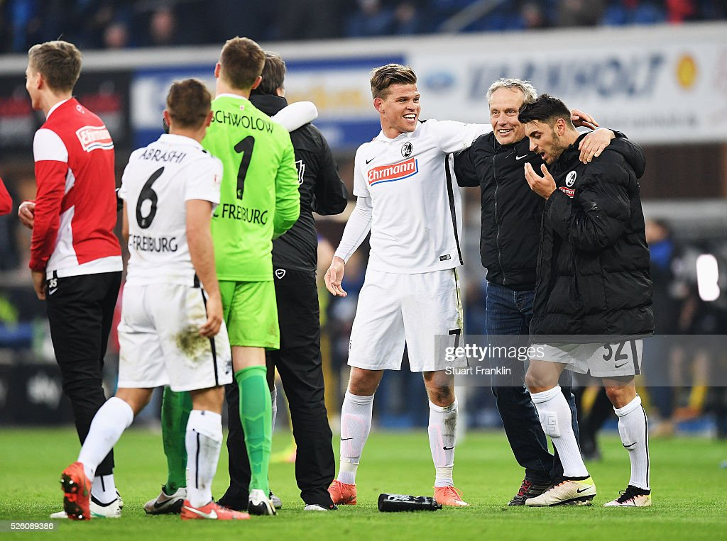 The players of Freiburg celebrate promotion to the first Bundesliga with <a gi-track='captionPersonalityLinkClicked' href=/galleries/search?phrase=Christian+Streich&family=editorial&specificpeople=4411796 ng-click='$event.stopPropagation()'>Christian Streich</a>, head coach of Freiburg after the second Bundesliga match between SC Paderborn and SC Freiburg at the Benteler Arena on April 29, 2016 in Paderborn, North Rhine-Westphalia.