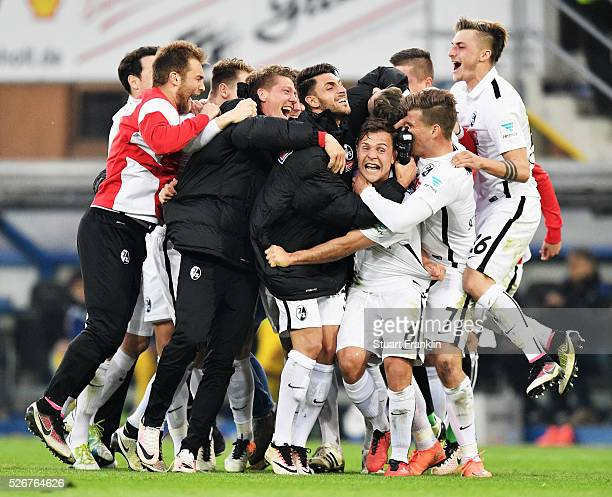 The players of Freiburg celebrate promotion to the first Bundesliga with Christian Streich head coach of Freiburg after the second Bundesliga match...