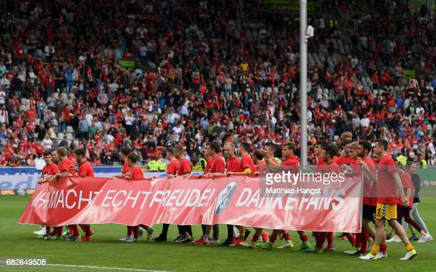 The players of Freiburg show a banner to thank the fans after the Bundesliga match between SC Freiburg and FC Ingolstadt 04 at SchwarzwaldStadion on...