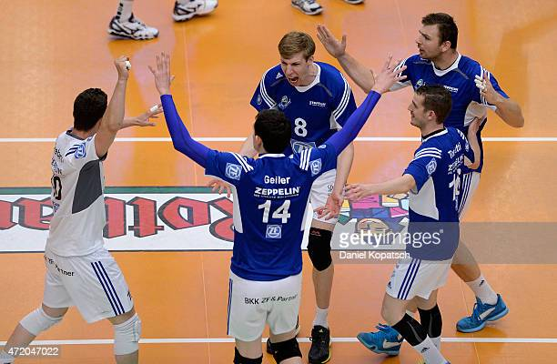 The players of Friedrichshafen celebrate during the Volleyball Bundesliga match between VfB Friedrichshafen and Berlin Recycling Volleys at ZF Arena...