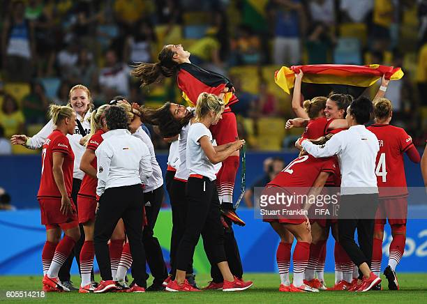 The players of Germany celebrate winning the Olympic Women's Football final between Sweden and Germany at Maracana Stadium on August 19 2016 in Rio...