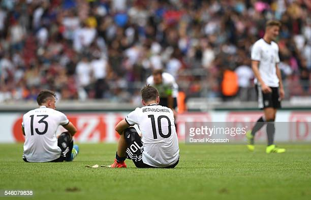 The players of Germany sit on the pitch after the UEFA Under19 European Championship match between U19 Germany and U19 Italy at MercedesBenz Arena on...