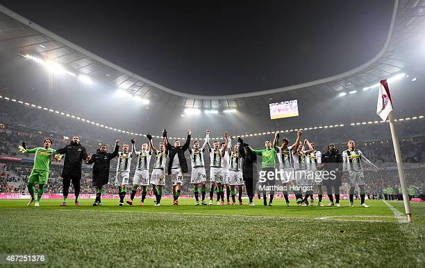 The players of Gladbach celebrate with their fans after the Bundesliga match between FC Bayern Muenchen and Borussia Moenchengladbach at Allianz...