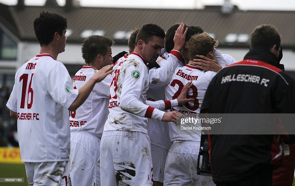 The players of Halle celebrate the team's third goal during the third Bundesliga match between SpVgg Unterhaching and Hallescher FC on February 3, 2013 in Unterhaching, Germany.
