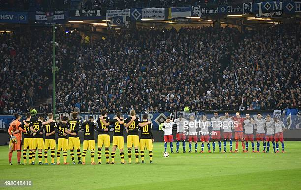 The players of Hamburg and Dortmund observe a minutes silence in memeory of tyhe 129 victims killed by terrorist in Paris before the Bundesliga match...