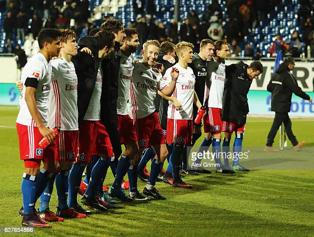 The players of Hamburg celebrat at the end of the Bundesliga match between SV Darmstadt 98 and Hamburger SV at Stadion am Boellenfalltor on December...