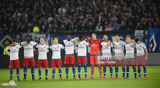 The players of Hamburg observe a minutes silence in memeory of tyhe 129 victims killed by terrorist in Paris before the Bundesliga match between...