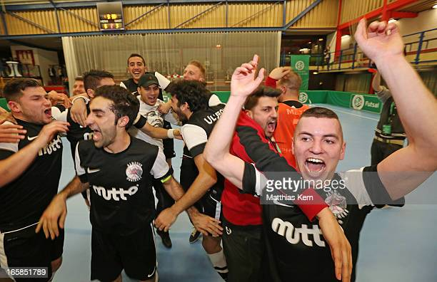 The players of Hamburg show their delight after winning the DFB Futsal Cup final match between Hamburg Panthers and UFC Muenster at Sporthalle...