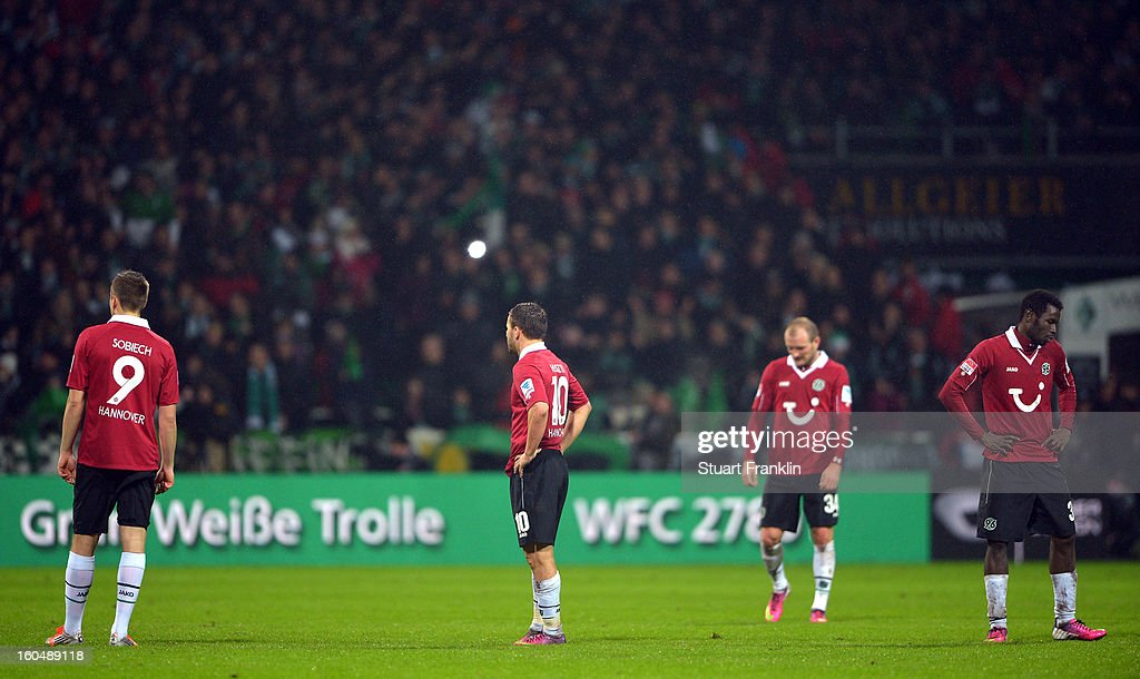 The players of Hannover look dejected during the Bundesliga match between SV Werder Bremen and Hannover 96 at Weser Stadium on February 1, 2013 in Bremen, Germany.