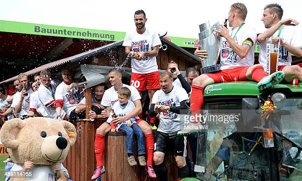 The players of Heidenheim celebrate the championship title win of the Third League at VoithArena on May 10 2014 in Heidenheim Germany