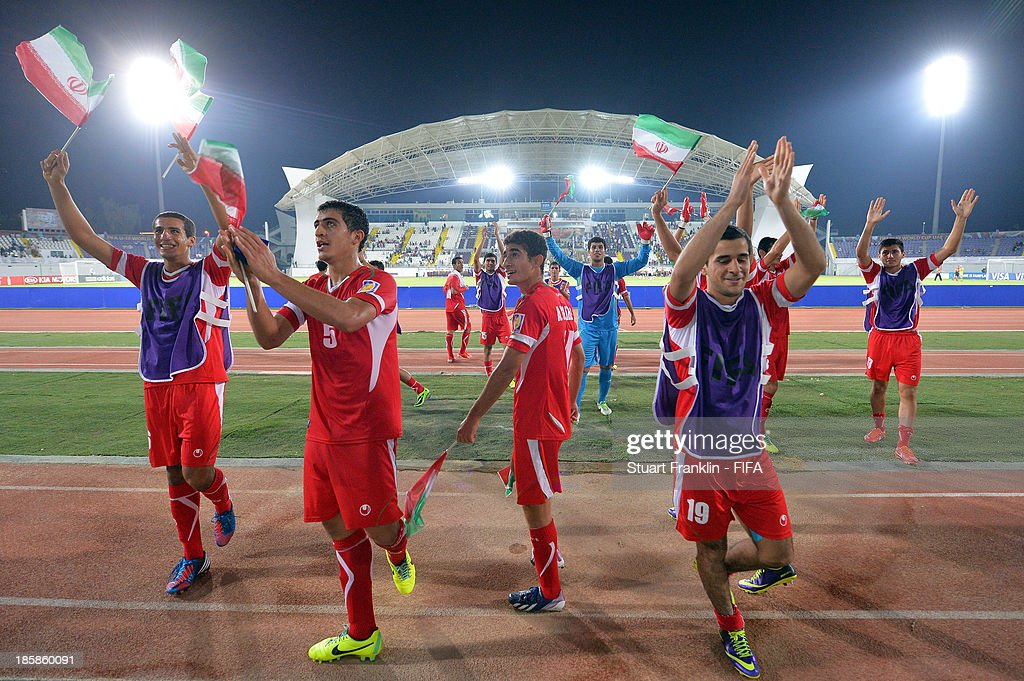 The players of Iran celebrate at the end of the FIFA U 17 World Cup group E match between Austria and Iran at Khalifa Bin Zayed Stadium on October 25, 2013 in Al Ain, United Arab Emirates.
