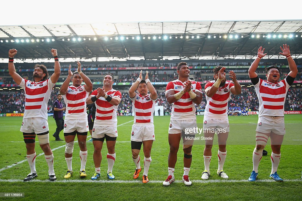 The players of Japan celebrate after the final whistle during the 2015 Rugby World Cup Pool B match between Samoa and Japan at Stadium mk on October...
