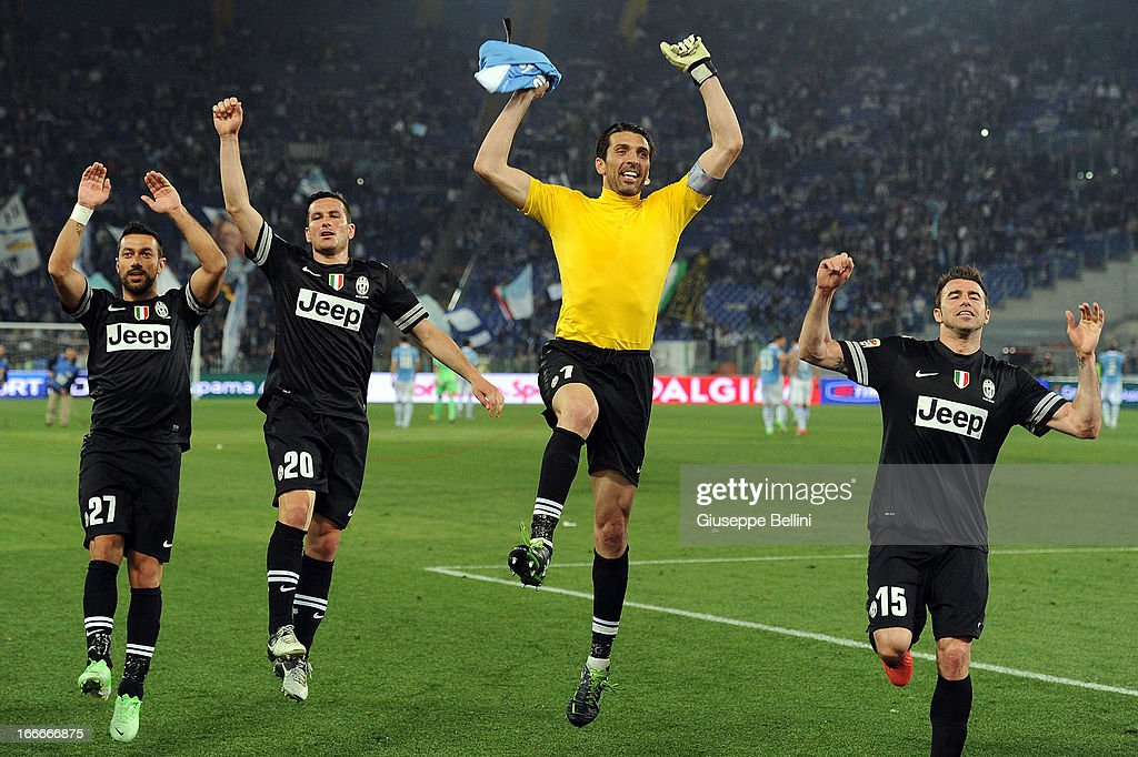 The players of Juventus celebrate their victory after the Serie A match between S.S. Lazio and Juventus at Stadio Olimpico on April 15, 2013 in Rome, Italy.