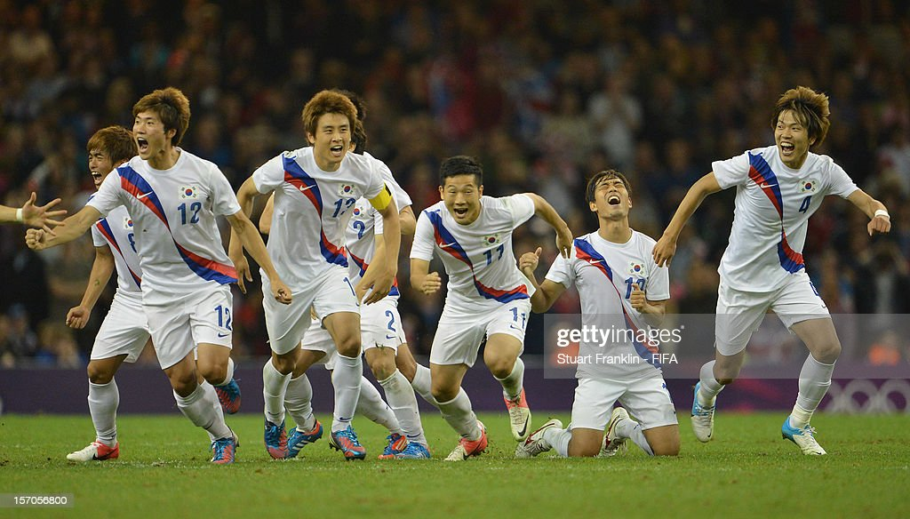 The players of Korea celebrate as their teams wins on penalties during the Men's Football Quarter Final match between Great Britain and Korea, on Day 8 of the London 2012 Olympic Games at Millennium Stadium on August 4, 2012 in Cardiff, Wales.