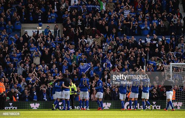 The players of Leicester City celebrate infront of the Leicester fans after the final whistle during the Barclays Premier League match between West...