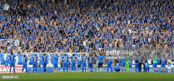 The players of Magdeburg celebrate with their supporters after winning the third league match between 1FC Magdeburg and Rot Weiss Erfurt at MDCC...