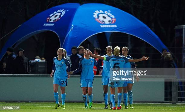 The players of Manchester City celebrate the 10 goal scored by Carli Lloyd during the UEFA Women's Champions League match between Fortuna Hjorring...
