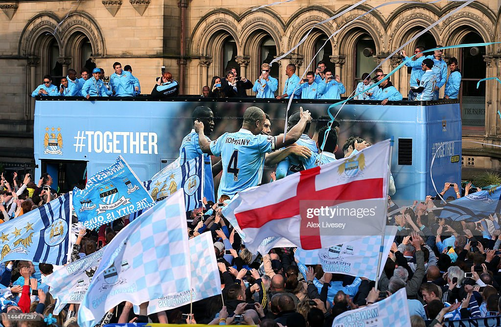 The players of Manchester City leave Manchester Town Hall in an open top bus for the start of their victory parade around the streets of Manchester on May 14, 2012 in Manchester, England.