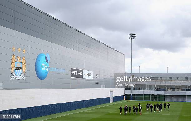 The players of Manchester City warm up during a training session at the City Football Academy on April 5 2016 in Manchester United Kingdom