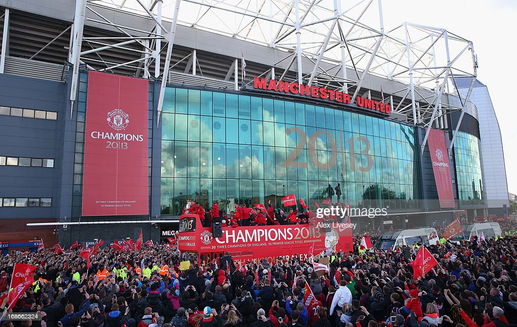 The players of Manchester United leave Old Trafford on an open top bus to start the Manchester United Premier League Winners Parade on May 13, 2013 in Manchester, England.