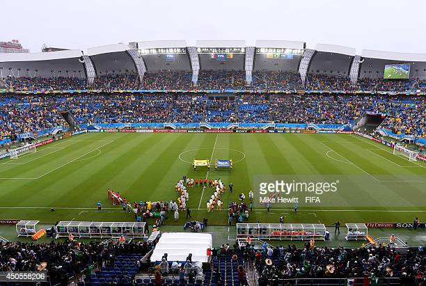 The players of Mexico and Cameroon line up prior to the 2014 FIFA World Cup Brazil Group A match between Mexico and Cameroon at Estadio das Dunas on...