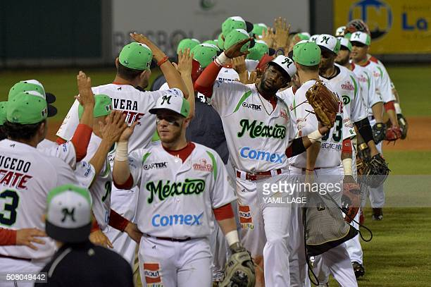 The players of Mexico celebrate after defeating Cuba in their 2016 Caribbean baseball series game on February 2 2016 in Santo Domingo Dominican...