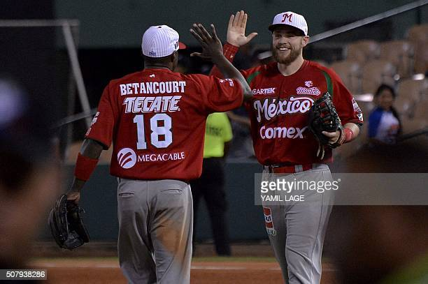 The players of Mexico celebrate after defeating Dominican Republic in their 2016 Caribbean baseball series game on February 1 2016 in Santo Domingo...