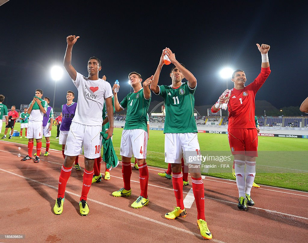 The players of Mexico celebrate at the end of the FIFA U 17 World Cup group F match between Sweden and Mexico at Khalifa Bin Zayed Stadium on October 25, 2013 in Al Ain, United Arab Emirates.