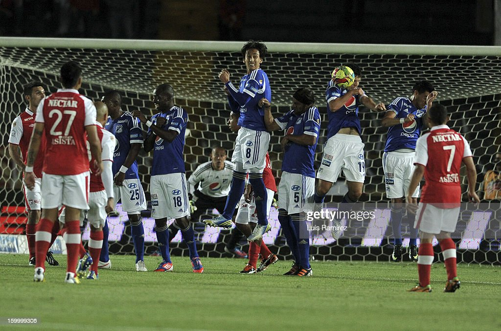 The Players of Millonarios in action during a match between Millonarios and Independiente Santa Fe as part of the Superliga Postobon 2013 at the Nemesio Camacho Stadium on January 24, 2013 in Bogota, Colombia.