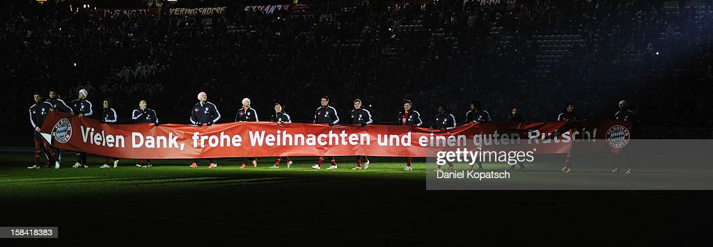 The players of Muenchen show a banner to wish merry christmas and a happy new year to their supporters after the Bundesliga match between FC Bayern Muenchen and VfL Borussia Moenchengladbach at Allianz Arena on December 14, 2012 in Munich, Germany.