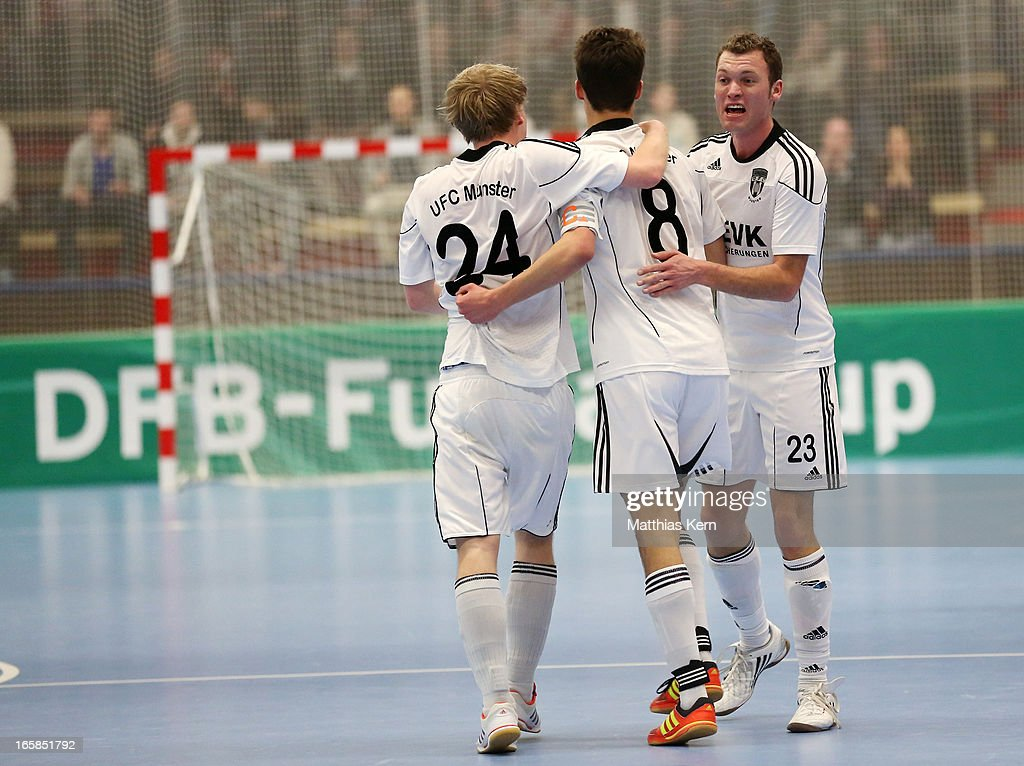The players of Muenster jubilate after scoring a goal during the DFB Futsal Cup final match between Hamburg Panthers and UFC Muenster at Sporthalle Wandsbek on April 6, 2013 in Hamburg, Germany.