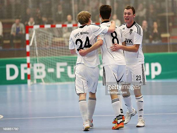 The players of Muenster jubilate after scoring a goal during the DFB Futsal Cup final match between Hamburg Panthers and UFC Muenster at Sporthalle...