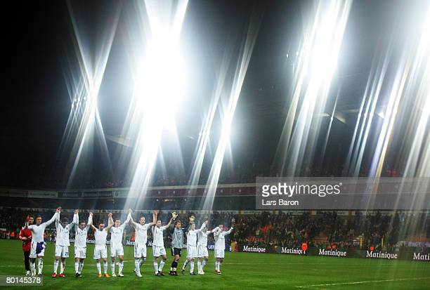 The players of Munich celebrate after winning the UEFA Cup Round of 16 first leg match between RSC Anderlecht and Bayern Munich at the Constant...
