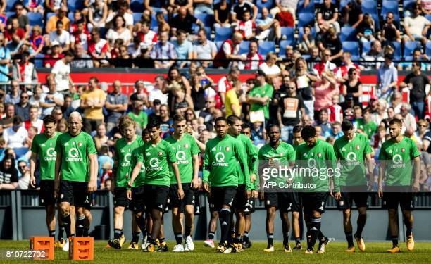 The players of Netherlands football league champions Feyenoord Rotterdam are cheered on by a crowd of fans during their first public training session...